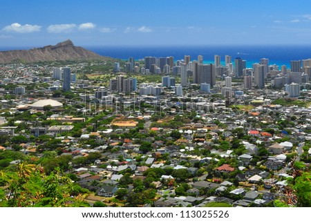 Diamond Head in the distance with city in the foreground - stock photo