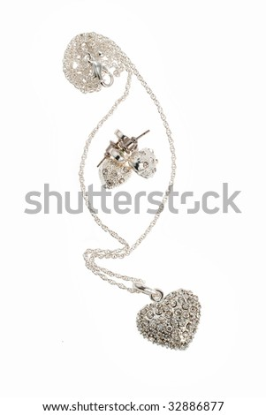 Diamond heart and earring on white background