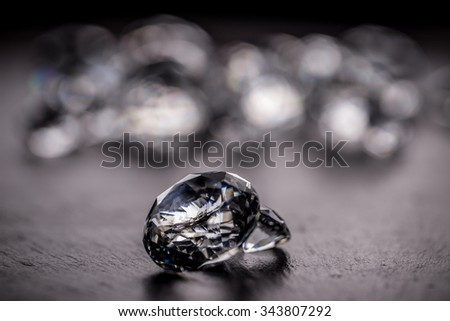 Diamond jewel onblack background - stock photo