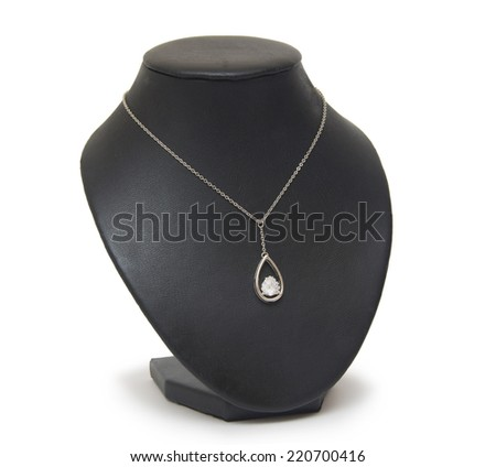 Diamond necklace on black mannequin isolated on white background  - stock photo