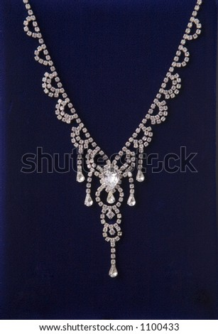 Diamond necklace on velvet - stock photo