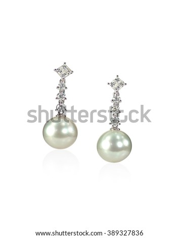 Diamond Pearl drop earrings isolated on white - stock photo