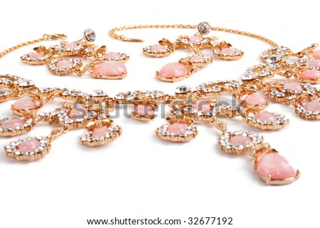 Diamond pendant with pink gems. Closeup