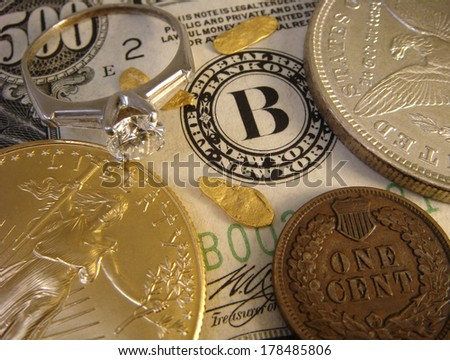 Diamond Ring, Gold American Eagle, Silver Eagle, Copper Cent, And Gold Nuggets, All Over A United States Five Hundred Dollar Note With Federal Reserve Bank Seal For New York, New York. - stock photo