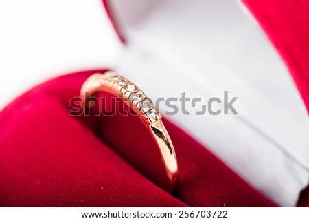 diamond ring in a velvet red box  - stock photo