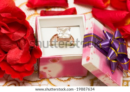 diamond ring in beautiful box with flowers
