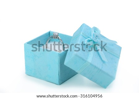 Diamond ring in box isolated on a white - stock photo