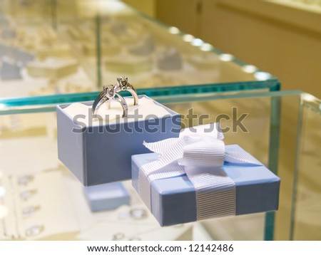 Diamond ring. Present gift in jewerly shop. - stock photo