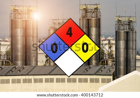Diamond-shape Flammable tank the most dangerous type on refinery background. - stock photo