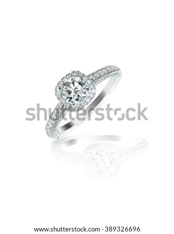 Diamond solitaire engagement wedding ring isolated on white - stock photo