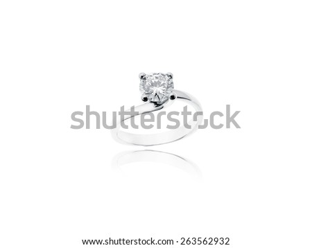 Diamond Solitaire Jewelry Ring in platinum on white background - stock photo