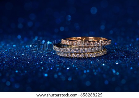 Diamond Stacked Rings On Blue Glitter Stock Photo Royalty Free