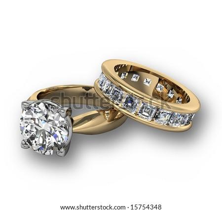 Diamond wedding ring set on white - stock photo