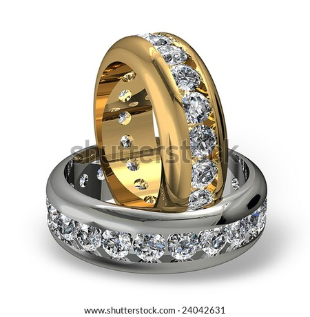 Diamond wedding rings on white - stock photo