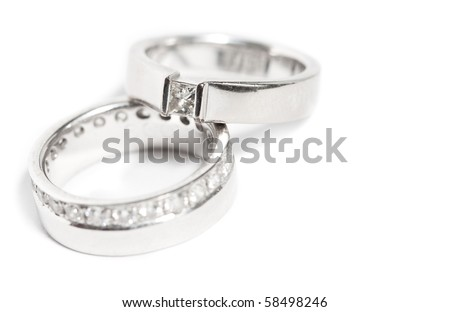 Diamond wedding rings on white background - stock photo