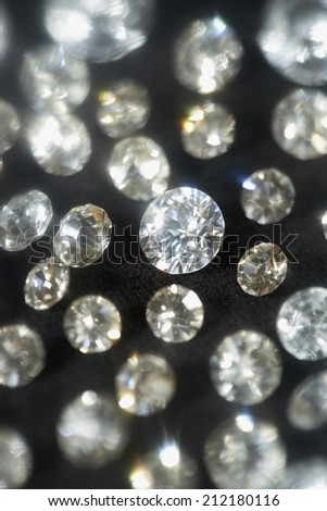 Diamonds on black background, selective focus - stock photo
