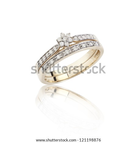 Diamonds ring on golden body shape the luxurious accessories - stock photo