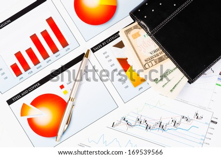 diary, a pen and business documents with charts, business still life