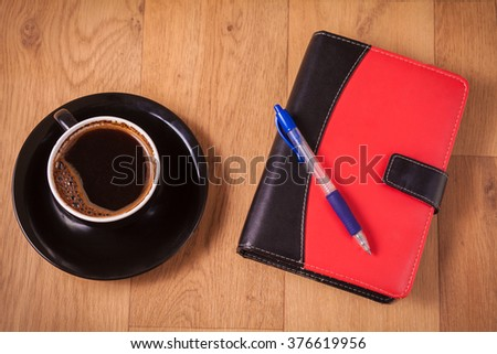 diary and coffee
