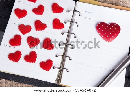 Diary note with red heart  (Organizer ,agenda, book, diary) - stock photo