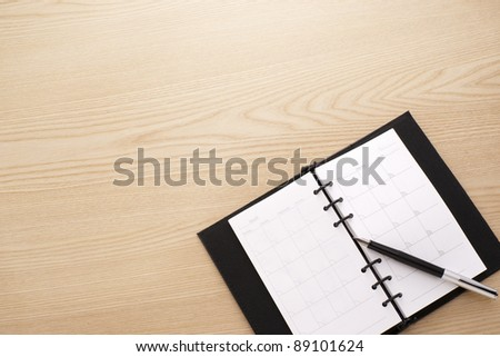 diary notebook with pen - stock photo