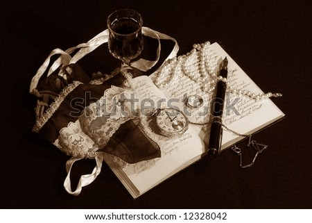Diary, pen, watch, wedding ring, and pearls
