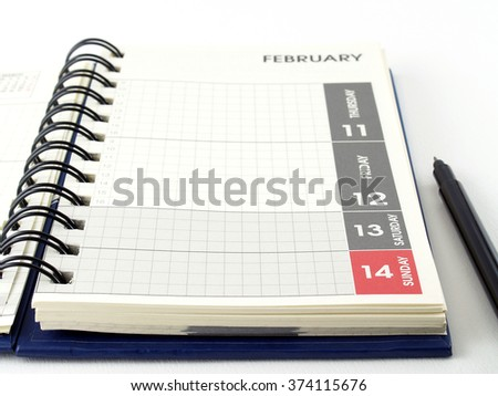 diary planner and pen on white background, page of the second week of February, each day plan in February - stock photo