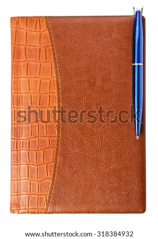 diary with a pen isolated on a white background - stock photo