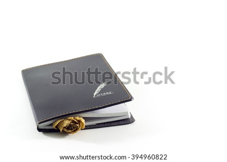 diary with a rose wither insert in white background insolate