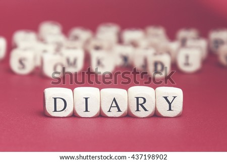Diary word written on wood cube with red background - stock photo