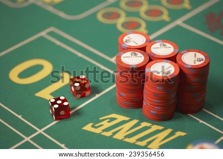 Dice and Chips on Roulette Table - stock photo