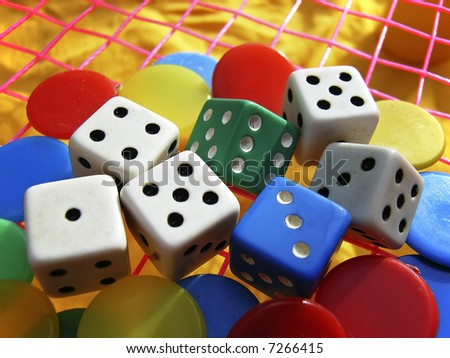 dice and pawns from a board game - stock photo