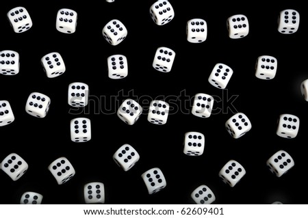 Dice background - isolated over black - stock photo