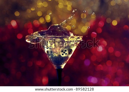 dice fall in a glass with martini. - stock photo