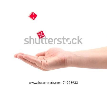 Dice falling into a female hand isolated against a white background - stock photo