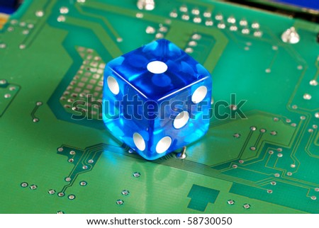 Dice on a computer motherboard concepts of online gambling - stock photo