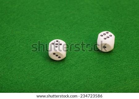 Dice On A Green Felt Table - stock photo