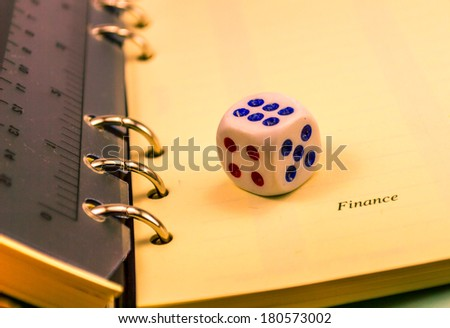 dice on an organizer closeup - stock photo