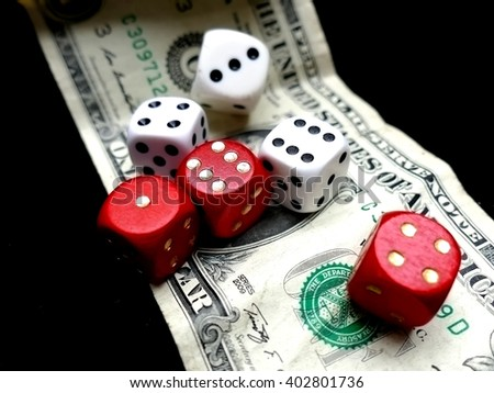 Dice on one dollar bill. Gambling concept - stock photo