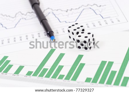 Dice on Stock Graphs and Pen - stock photo