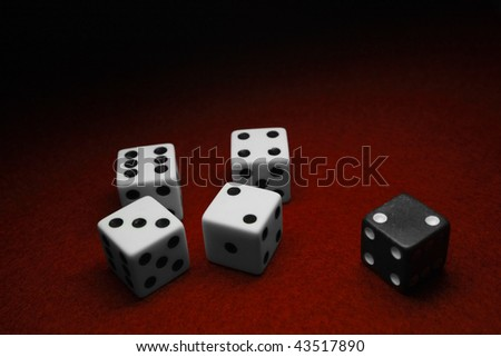 Dice over red felt, separated by color - stock photo
