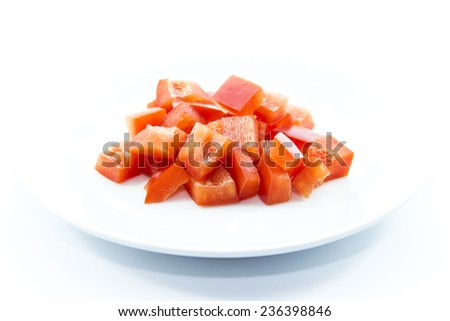 Dice red bell chili cutting ingredient on white background  - stock photo