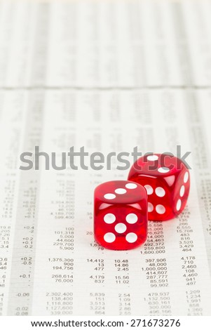 Dice rest on stock price detail financial newspaper
