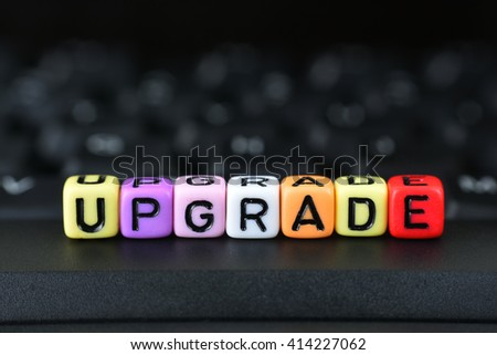 Dice With Word Upgrade On Keyboard - stock photo