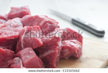 Diced raw meat and a knife