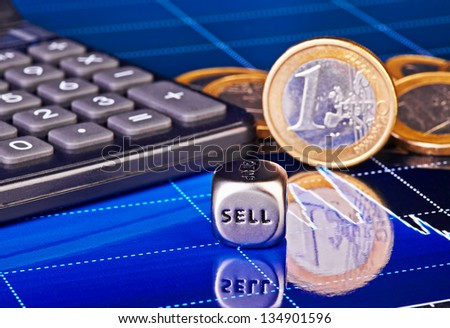 Dices cube with the word SELL, euro coins, calculator and downtrend financial chart as background. Selective focus - stock photo