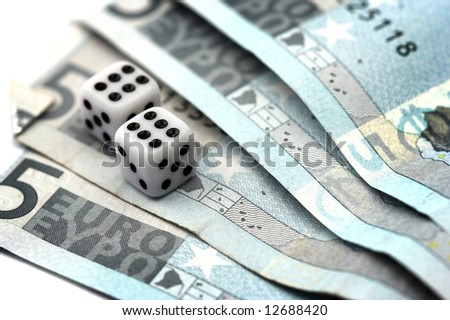 Dices over euro bills close up - stock photo