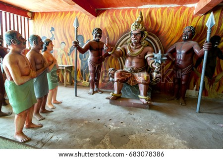 DICKWELLA, SRI LANKA - SEPTEMBER 03, 2013 : Sinners prepare to face their punishment in a scene displayed in the Chamber of Horrors at Wewurukannala Vihara at Dickwella, Sri Lanka.