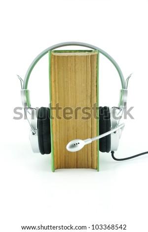 Dictionary and headphone - stock photo