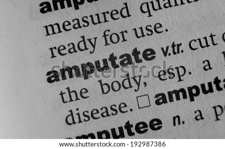 Dictionary definition of the word Amputate - stock photo